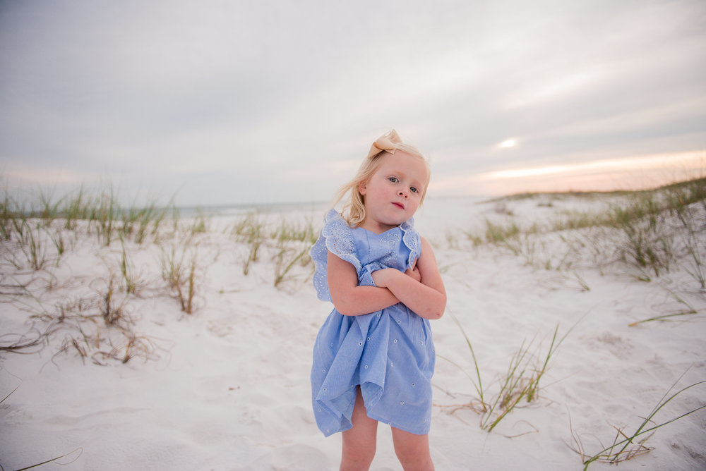 girl at beach with hands crossed-Pensacola Beach Family Photographer