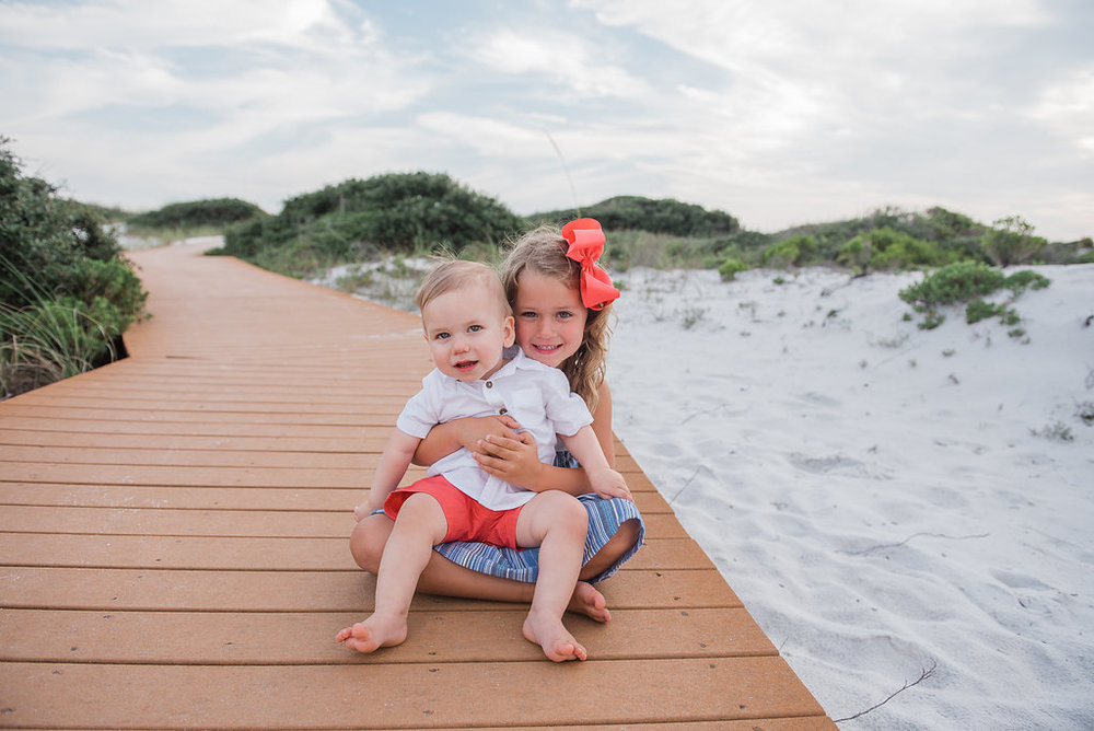 brother and sister at beach-Pensacola Photographer