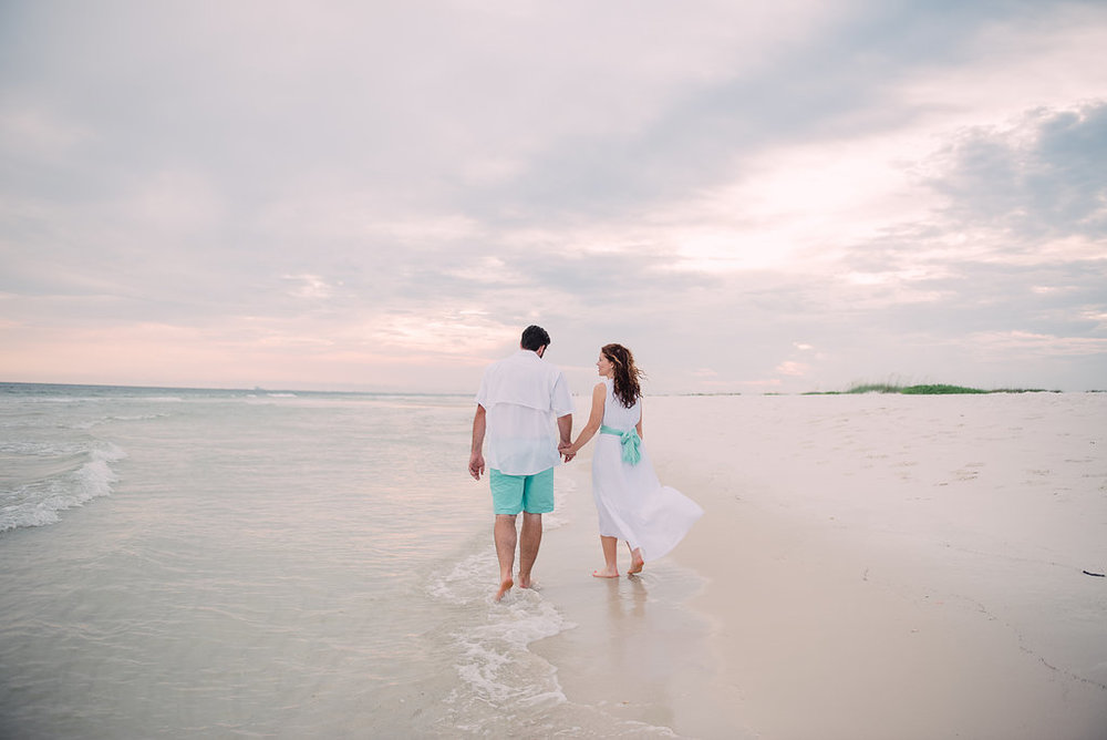 walking in sand couple-pensacola photographer