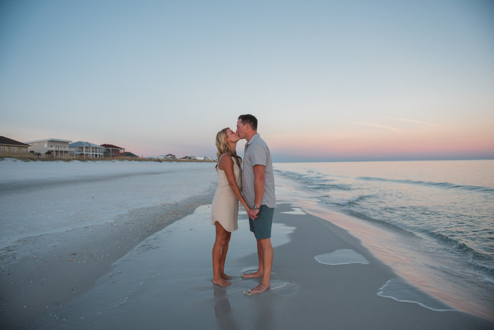 couple kissing at beach- pensacola family photographer