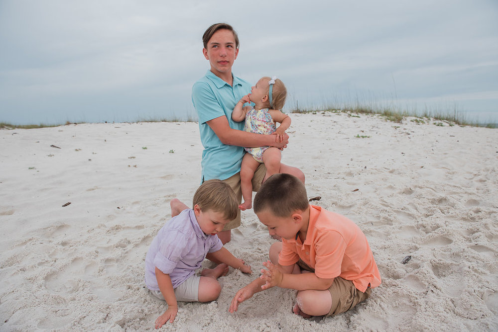 kids digging in sand-Pensacola Beach Family Photographer