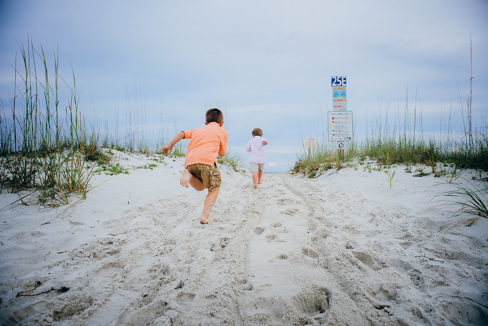 kids running in sand-Pensacola Beach Family Photographer