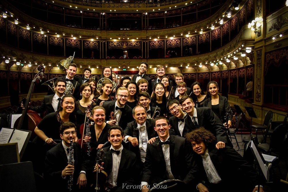 The orchestra poses for a picture with conductor Federico Cortese