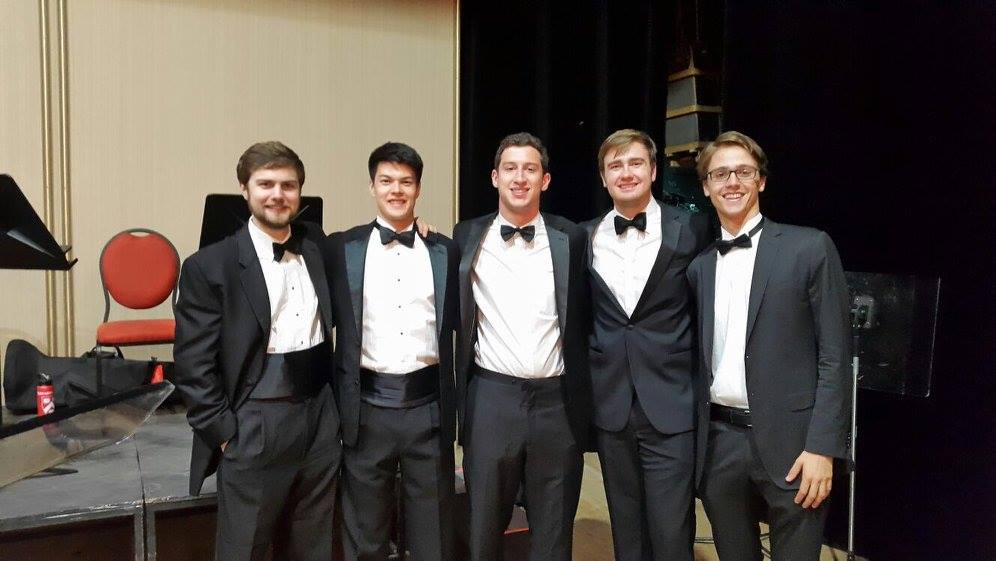 Patrick Sanguineti '17, Alec Jones '19, William Brechtelsbauer '19, Jack Stone '20, and Sasha Scolnik-Brower '17 smile before a concert  Photo by Ellis Yeo '20