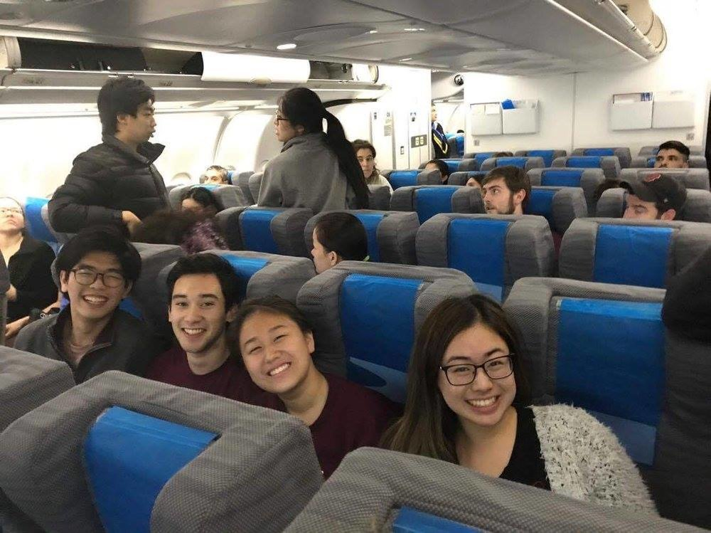 """John Lim '20, Brandon Duffy '20, May Wang '20, and Jeanna Qiu '20—all members of the """"Famous Quartet""""—sat together on the plane  Photo by NaYoung Yang '18"""