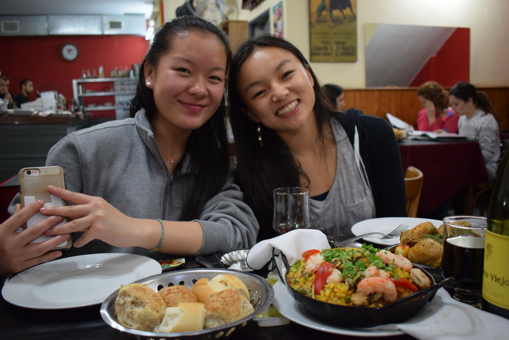 Anna Peng '20 and Anya Zhang '20 prepare for a meal of paella   Photo by Ellis Yeo '20