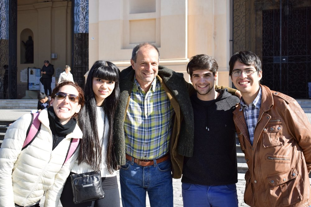 Conductor Federico Cortese poses with four Argentinian musicians  Photo by Ellis Yeo '20