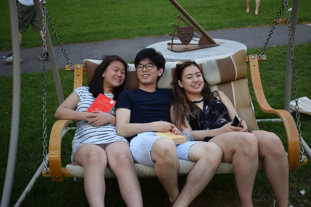May Wang '20, John Lim '20, and Jeanna Qiu '20 relax after a long day of rehearsals   Photo by Ellis Yeo '20