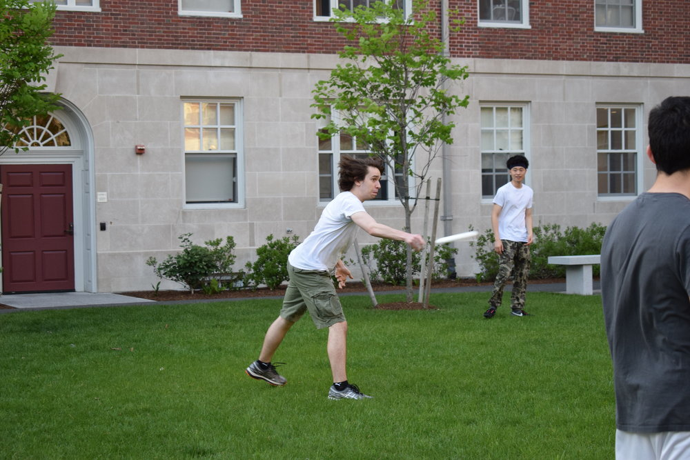 Christian Lin '20 watches as Mason Meyer '20 throws a frisbee with precision and speed  Photo by Ellis Yeo '20