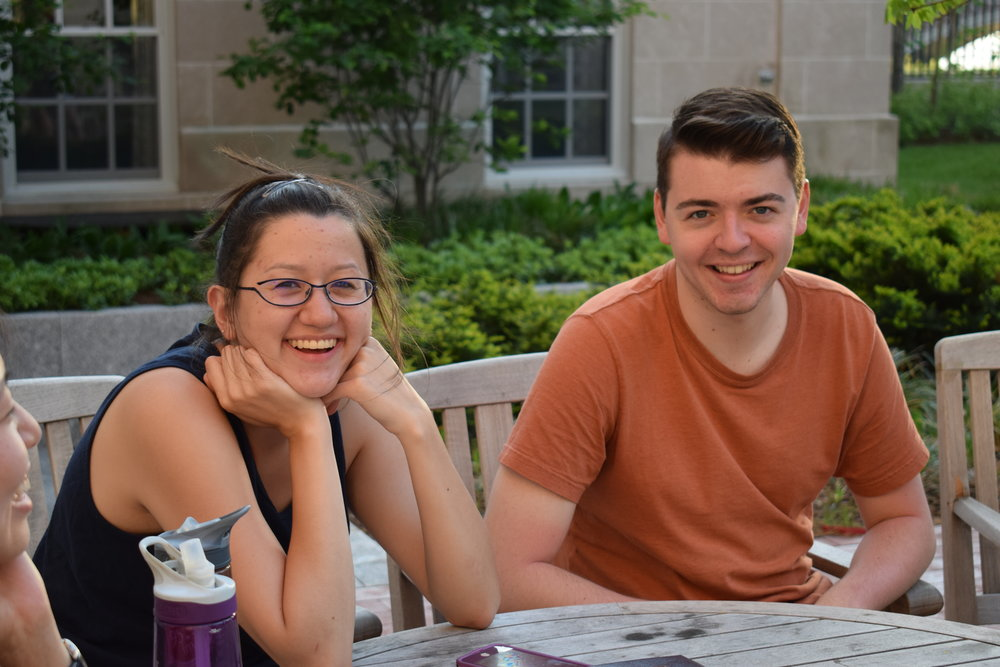 Anna Clink '17 and Brendan Pease '17 relax in the Dunster House courtyard before tour  Photo by Ellis Yeo '20