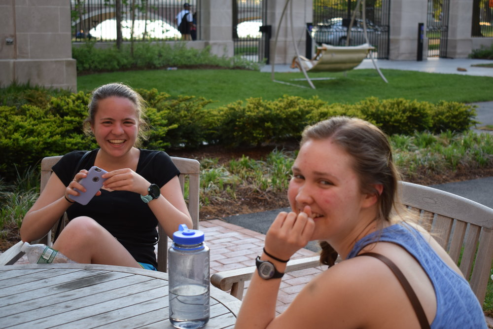 Mara Roth '19 and Claire Criscione '19 enjoy an evening in the Dunster courtyard  Photo by Ellis Yeo '20