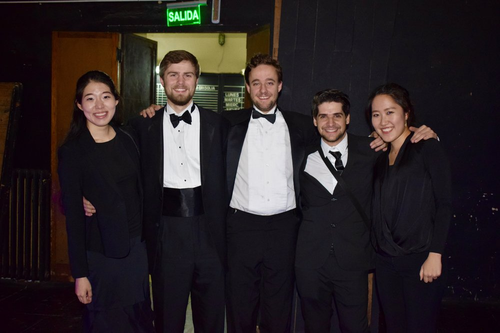 NaYoung Yang '18, Patrick Sanguineti '17, Tommy Peeples '17, Juan Manuel Fernandez Rossi, and Ellis Yeo '20 smile after the Cordoba concert