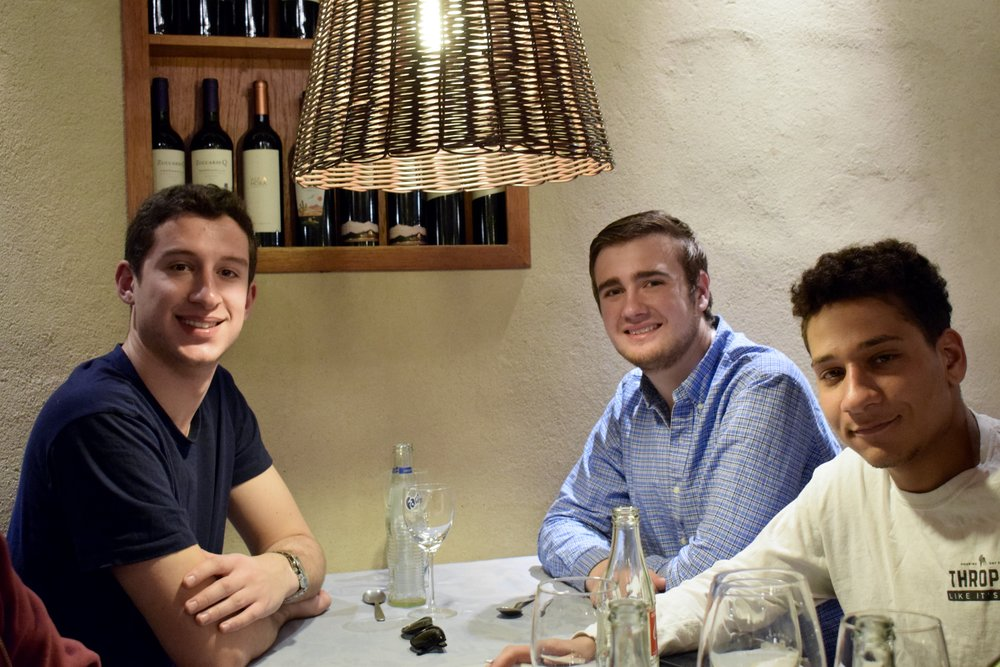 Jack Stone '20, William Brechtelsbauer '19, and Myer Johnson-Potter '20 sit at the farewell dinner  Photo by Ellis Yeo '20