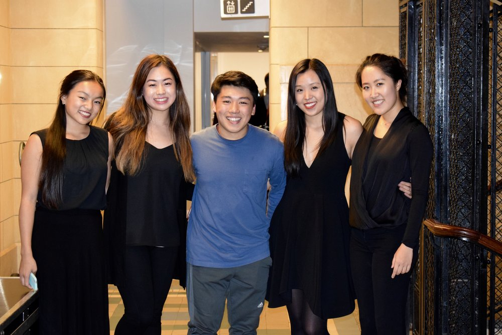 Anya Zhang '20, Jeanna Qiu '20, George Li '18, Angela Tang '20, and Ellis Yeo '20 smile before a concert