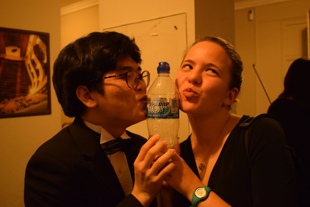 John Lim '20 and Mara Roth '19 express their love for bottled water - a precious resource backstage!  Photo by Ellis Yeo '20