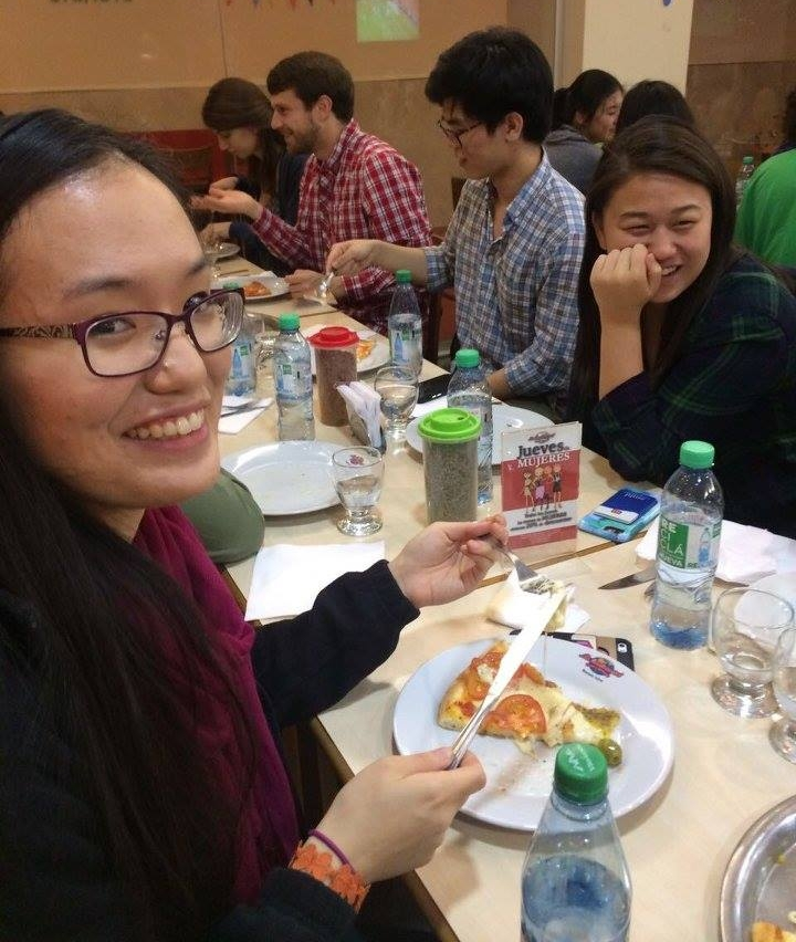 Cecilia Yao '18 enjoys an extra-cheesy slice of pizza pie  Photo by Ellis Yeo '20
