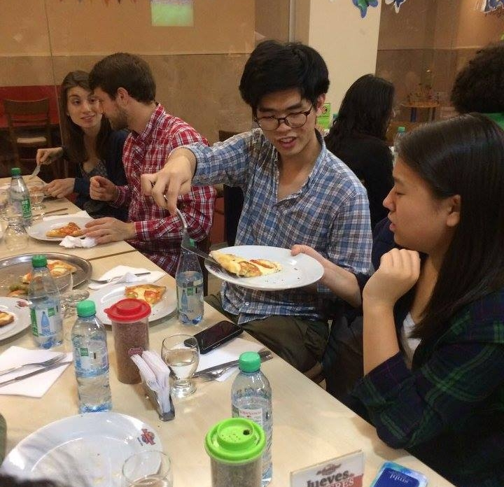 John Lim '20 serves up a delicious slice of pizza to May Wang '20  Photo by NaYoung Yang '18