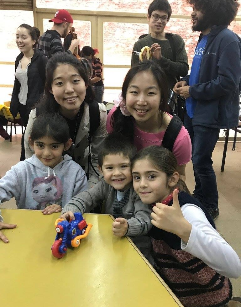 NaYoung Yang '18 and Enchi Chang '17 smile with young Argentinian music students