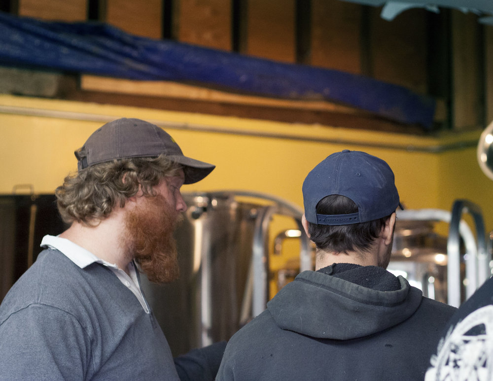 Evan Watson, owner of Plan Bee and Michael over looking the brewhouse