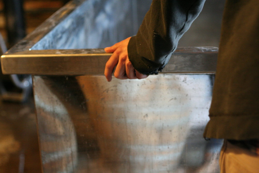 Our barrel's reflection in the metal of the coolship