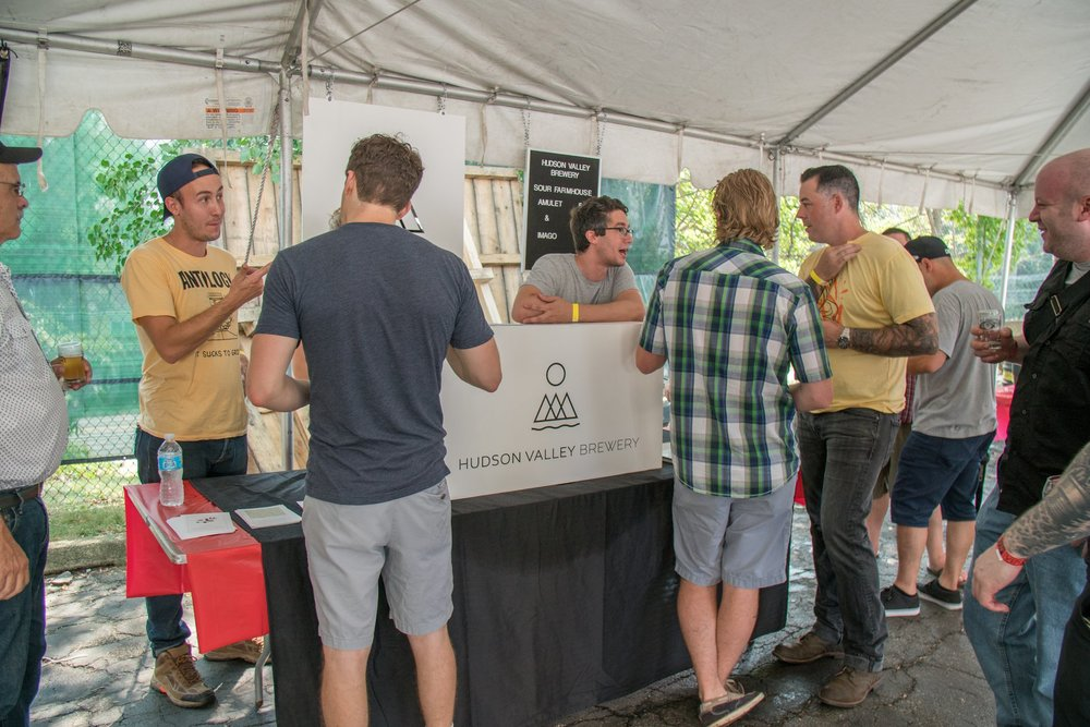 Photo of Mike and Jason engaging with customers at Sour'd in September