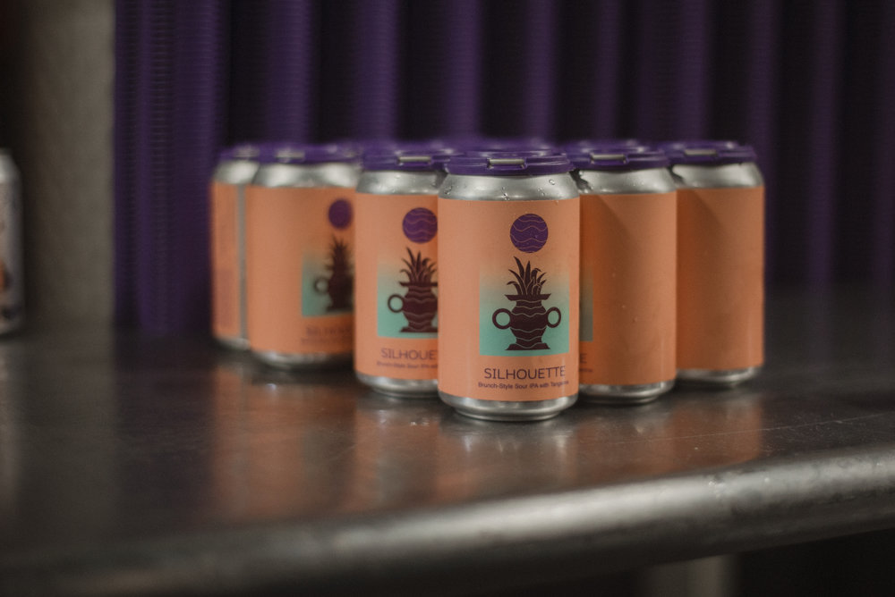 Photo of Tangerine Silhouette cans