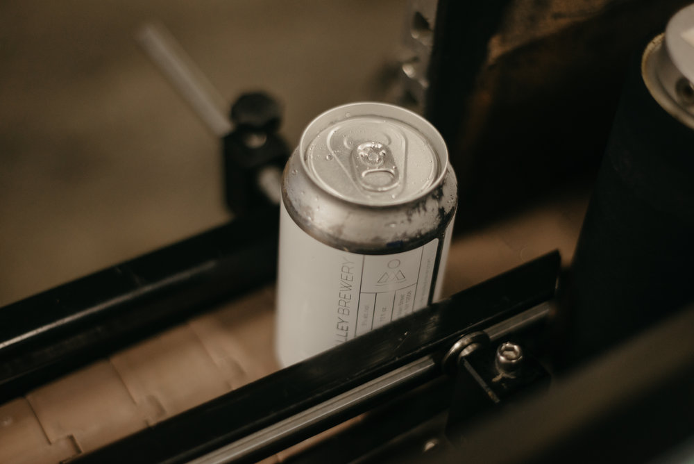 Photo of a can of Feel No Way on the canning line