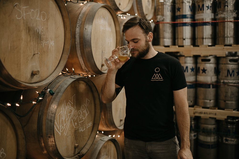 Photo of Conor tasting a sample of Valley Beer
