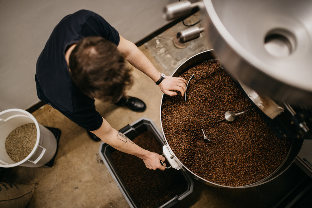 Photo of Alex from Big Mouth Coffee Roasters overseeing the cooling process