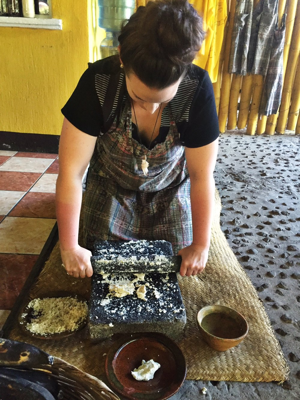Grinding the corn for tortillas