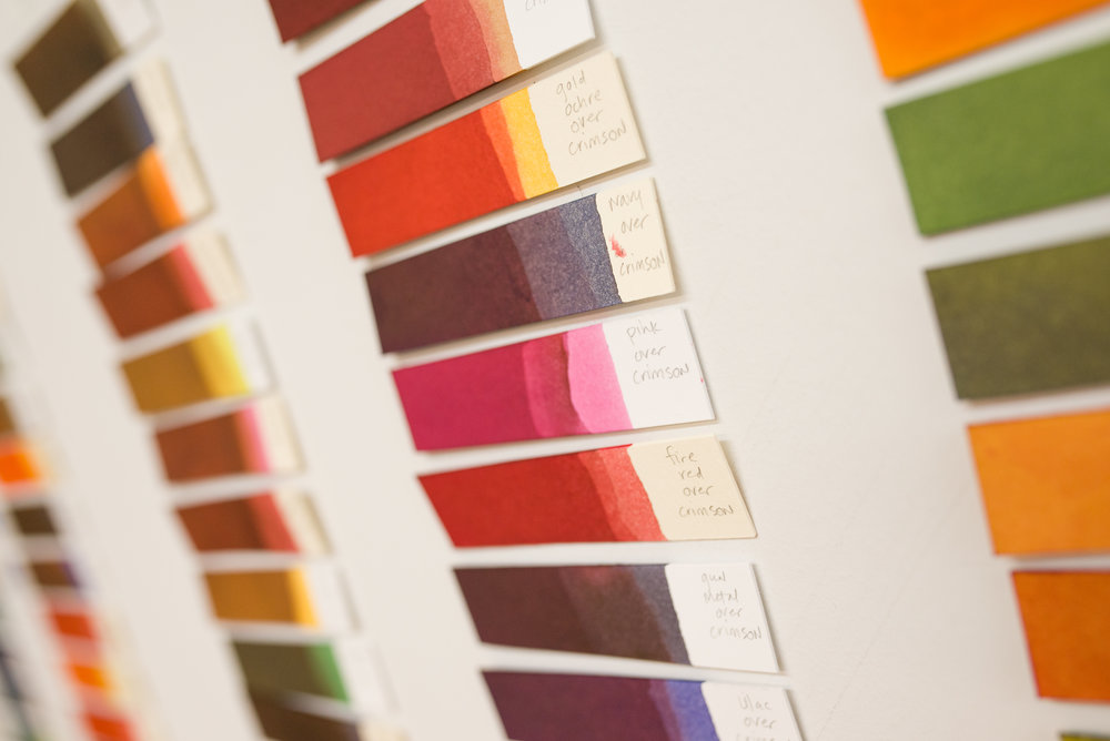 Swatches of color line the walls of Wendy's studio