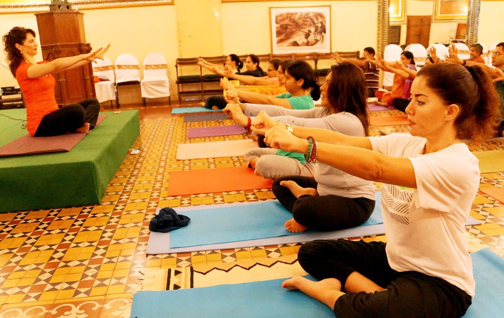 Devi conducting morning Yoga in Chennai, India, Mohanji's Pancha Tatwa Retreat, Nov 2015.jpg