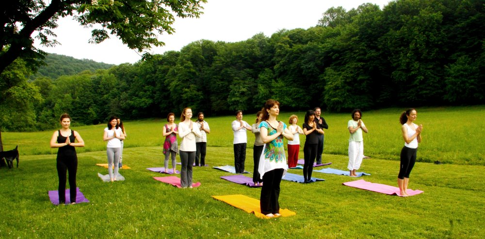 Devi guiding the merry group into Sun Salutations, Mohanji's Retreat in Andrevlje, Serbia, 2013.jpg