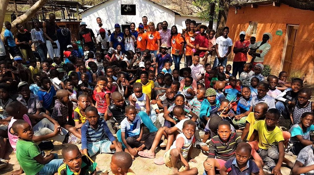 DEVI WITH ACT SOUTH AFRICA TEAM FEEDING THE NEEDY CHILDREN AT SHUMBASHABA NEAR JOHANNESBURG, SEPTEMBER 2017