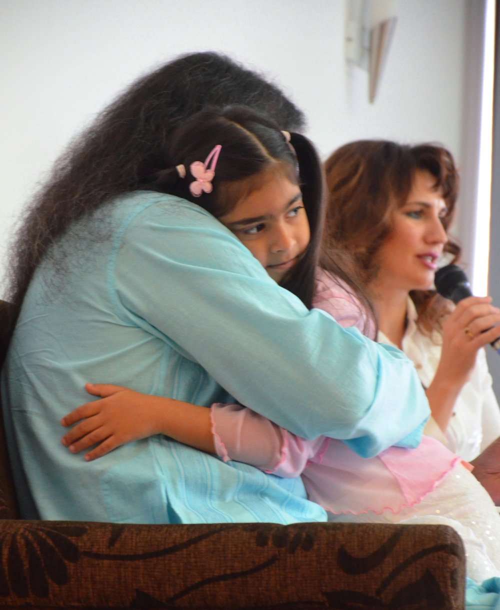 """The M family (Mohanji, Devi and daughter Mila)    Devi says: """"We don't get to spend much time together, but our love is deep and eternal. It includes so many other people around the world, for it is the nature of Love to expand so that we can share our inner wealth and grow together..."""""""
