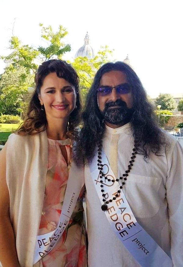 DEVI MOHAN AND MOHANJI AT THE PEACE PLEDGE EVENT IN ASSISI, ITALY IN JUNE 2018.