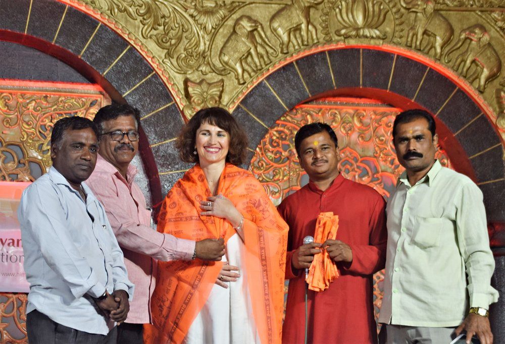 Devi honored on stage.jpg