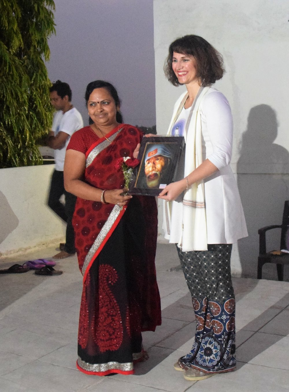 Devi honored with Sai picture and shawl.jpg