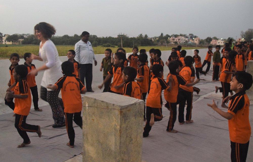 Devi jumping with children.jpg