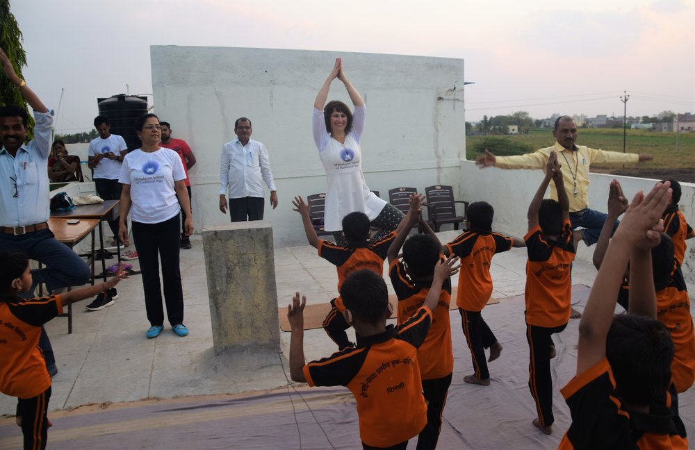 Devi leading children into Tree Pose.jpg