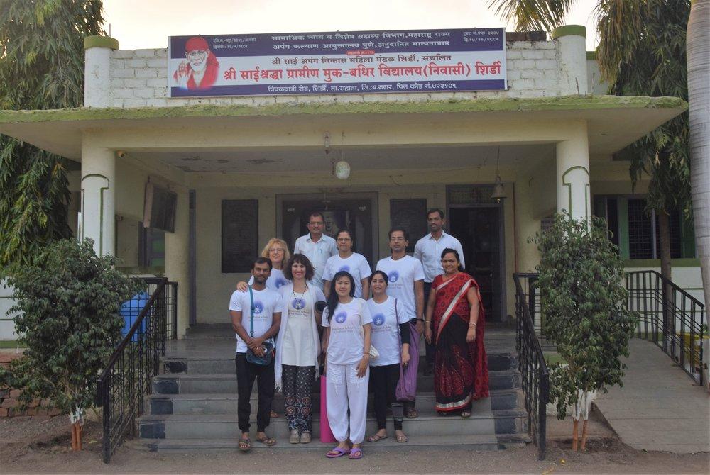 HSTY team at the school, posing.jpg