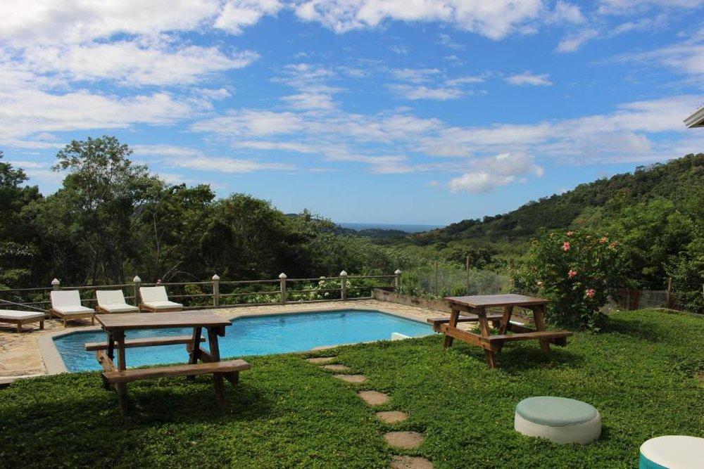 coconut-surf-camp-nicaragua-villa-backyard-pool.jpg