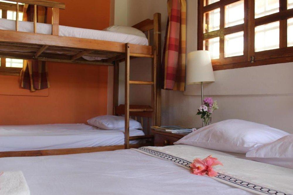 coconut-surf-camp-nicaragua-villa-bedroom.jpg