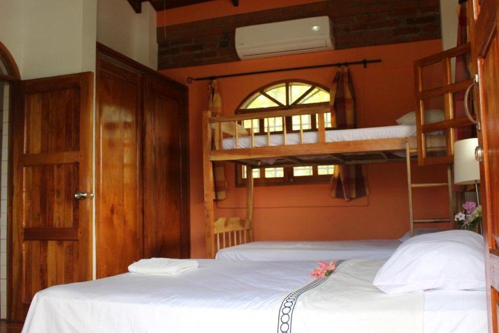coconut-surf-camp-nicaragua-villa-suite-beds.jpg