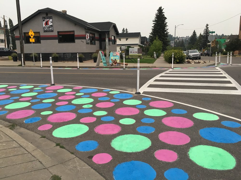 A micro grant in Bridgeland-Riverside helped the community and great volunteers run a pilot project in order to calm traffic and make streets safer for pedestrians. Photo source:  Elan LaMontagne