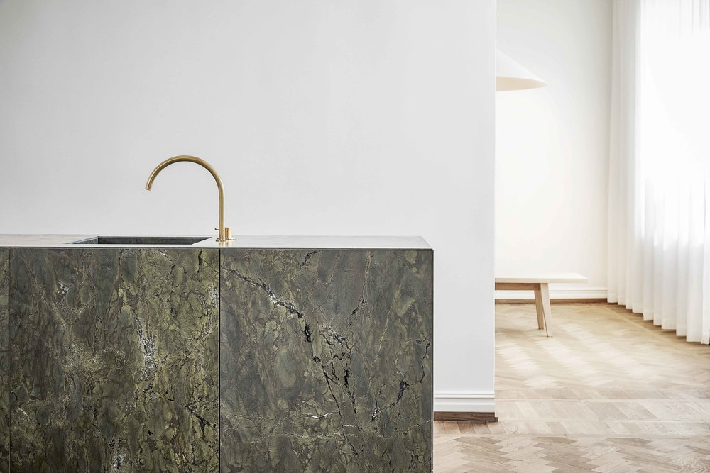 Wästberg showroom featuring turtle green marble kitchen by Ballingslöv