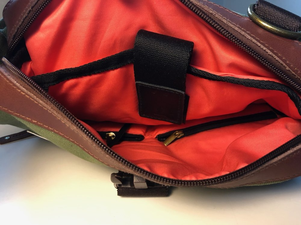 A laptop sleeve and two large zipped pockets on the interior (in backpack mode)