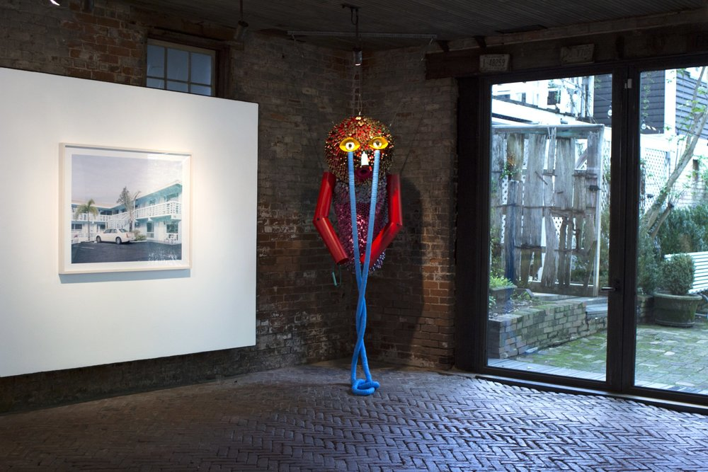 "Installation view of ""Luminous Animals"" at Whitespace with (l to r) photo by Caroline Allison and hanging sculpture by Alex Lockwood."