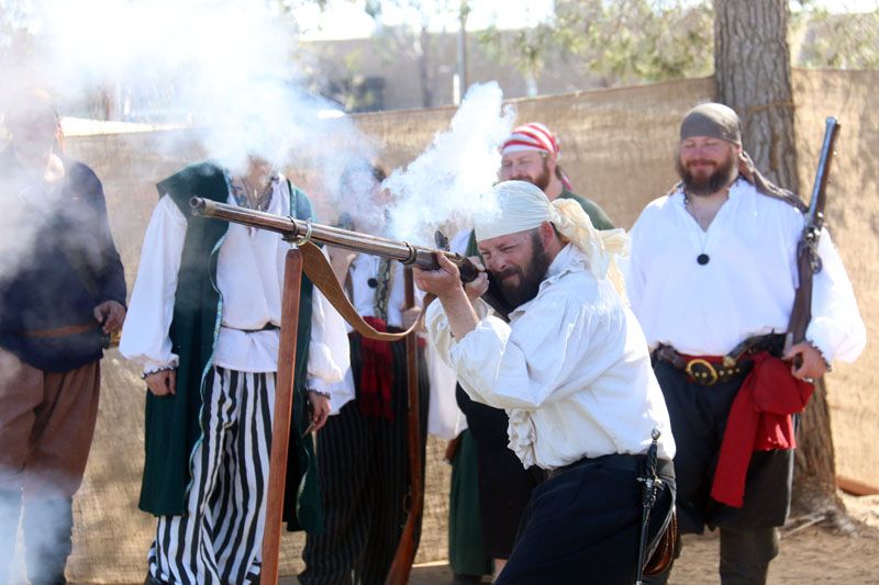 flintlock long gun firing; High desert pirate renaissance faire