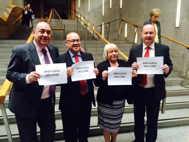 Alex Salmond MSP MP, James Dornan MSP, Sandra White MSP and Bill Kidd MSP all supporting #refugeeswelcome in the Scottish Parliament.